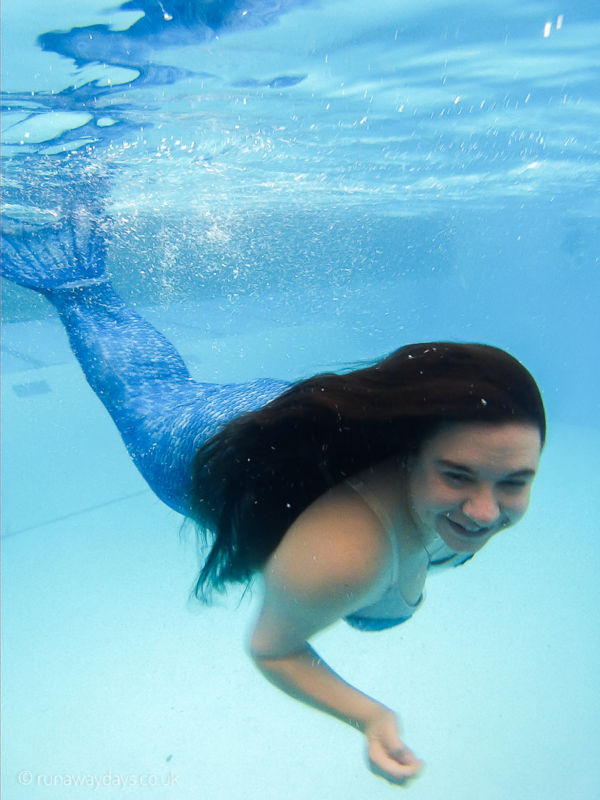 Carla underwater in a mermaid tail